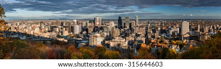 Montreal panorama as viewed from the Mount Royal on a late afternoon. - stock photo