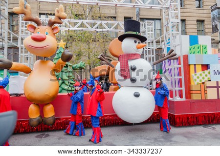 MONTREAL, QUEBEC, CANADA - NOVEMBER 21, 2015 : Funny platform with giant figures in 65th edition of the Santa Claus Parade Destination Centre-ville (Defile du Pere Noel) along Saint Catherine Street. - stock photo