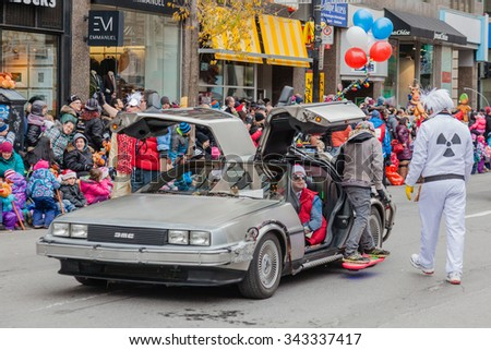 MONTREAL, QUEBEC, CANADA - NOVEMBER 21, 2015 : Marty McFly and Doc with DeLorean in 65th edition of the Santa Claus Parade Destination Centre-ville (Defile du Pere Noel) along Saint Catherine Street. - stock photo
