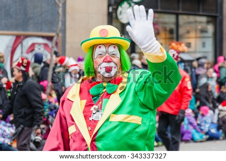MONTREAL, QUEBEC, CANADA - NOVEMBER 21, 2015 : Old clown in the 65th edition of the Santa Claus Parade Destination Centre-ville (Defile du Pere Noel) along Saint Catherine Street. - stock photo
