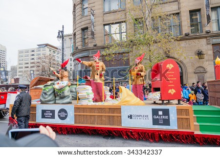 MONTREAL, QUEBEC, CANADA - NOVEMBER 21, 2015 : Santa Claus Post platform in the 65th edition of the Santa Claus Parade Destination Centre-ville (Defile du Pere Noel) along Saint Catherine Street. - stock photo