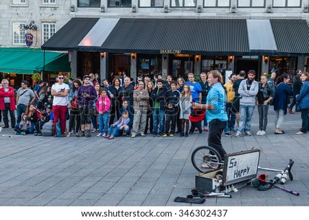 MONTREAL, QUEBEC, CANADA - SEPTEMBER 20, 2015 : City evening on square Place Jacques Cartier. Street performer in public on dusk on September 20, 2015. - stock photo