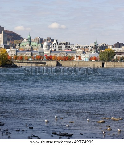 Montreal skyline and Saint Lawrence River in fall - stock photo
