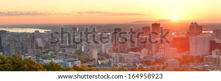 Montreal sunrise panorama viewed from Mont Royal with city skyline in the morning - stock photo
