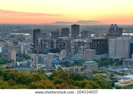 Montreal sunrise viewed from Mont Royal with city skyline in the morning - stock photo
