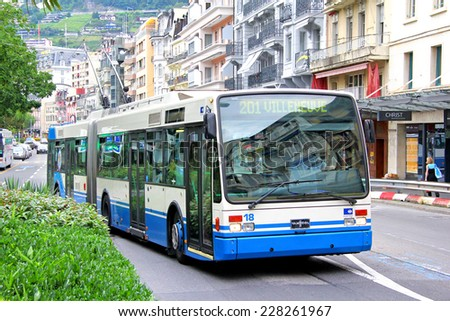 MONTREUX, SWITZERLAND - AUGUST 6, 2014: Articulated trolleybus Van Hool AG300T at the city street. - stock photo