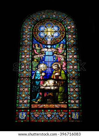 Montserrat, Catalonia, Spain - September 09, 2014: Nativity scene. Stained glass window in the  Basilica of  the  Benedictine Monastery   Montserrat, located in the mountains 56 km from Barcelona.  - stock photo