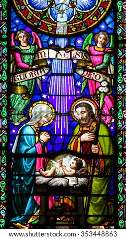 MONTSERRAT, SPAIN - JULY 17, 2014: Stained glass window depicting a Nativity Scene at Christmas in the abbey of Santa Maria de Montserrat in Catalonia, Spain - stock photo