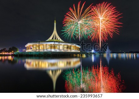 Monument at public park Suan Luang Rama 9 with Colorful Fireworks, Thailand - stock photo