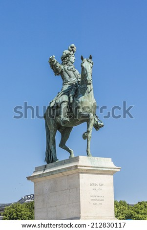 Monument by Louis XIV in front of Versailles Palace. Palace Versailles was a royal chateau. It was added to UNESCO list of World Heritage Sites - stock photo