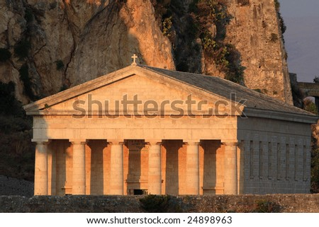 Monument in the old castle of Corfu town  at sunset - stock photo