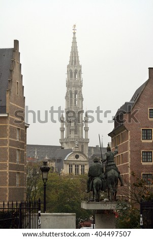 Monument of Don Quixote and Sancho Panza and backgroung City Hall on the Grand Place. Brussels, Belgium. October, 2007. - stock photo