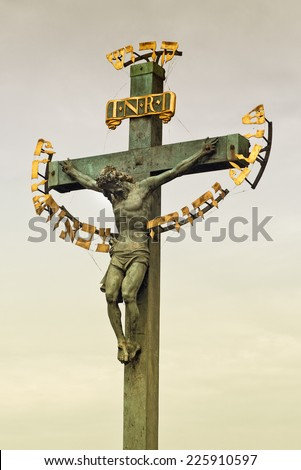 """Monument of Jesus Christ crucifixion at Charles Bridge in Prague with the Hebrew reading """"King of the Jews"""" dating from 17th century - stock photo"""