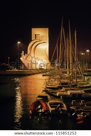 Monument to the discoveries and yacht basin at night, Lisbon, Portugal, Western Europe. - stock photo