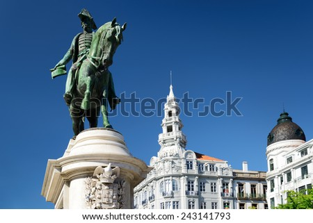 Monument to the first king of Portugal Don Pedro IV on the Liberty Square in Porto. Porto is one of the most popular tourist destinations in Europe. - stock photo