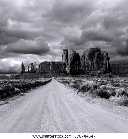 Monument Valley Arizona with evening cloudy skies - stock photo