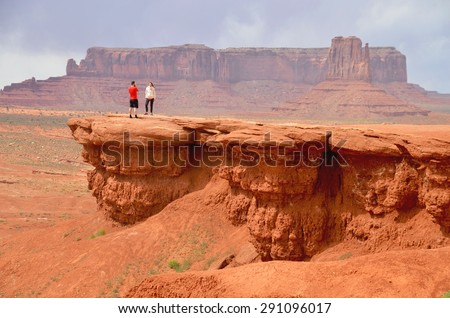 MONUMENT VALLEY, AZ - MAY 21: Couple at Monument Valley on May 21, 2015 Arizona,USA. Thousands of people from all over the world come to visit this beautiful place every year - stock photo