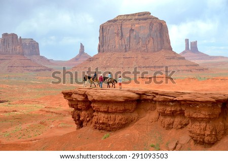 MONUMENT VALLEY, AZ - MAY 21: Horseback Riding at Monument Valley on May 21, 2015 Arizona,USA. Thousands of people from all over the world come to visit this beautiful place every year - stock photo