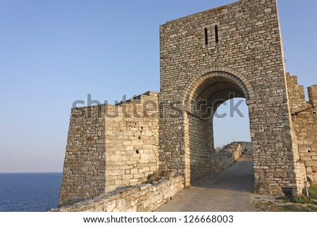 Monumental entrance of medieval fortress of Kaliakra. Bulgaria. Cape of Kaliakra is a long and narrow headland in the Southern Dobruja region of the northern Bulgarian Black Sea Coast - stock photo