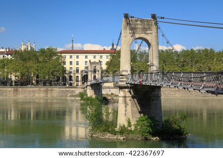 Monumental Passerelle du College bridge over Rhone river in Lyon, France, on a spring day. - stock photo