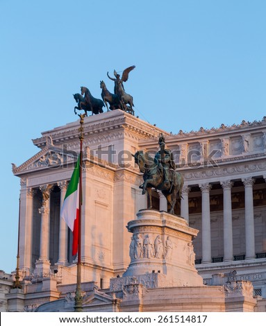 Monuments and Statues at the Vittoriano Emanuele Monument in central Rome at sunset - stock photo