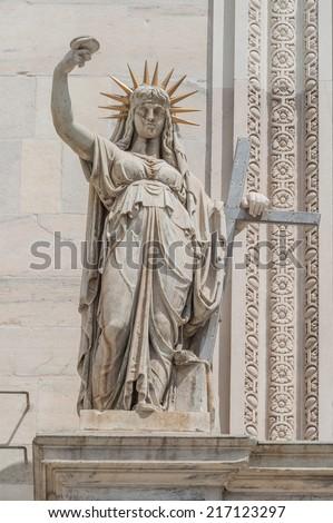 Monuments at facade of the Cathedral of Milano, Duomo di Milano, Italy, summer 2014 - stock photo