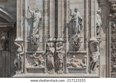Monuments at facade of the Cathedral of Milano, Duomo di Milano, Italy, summer 2014 - stock photo