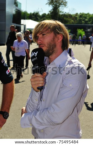 MONZA, ITALY - SEPTEMBER 11 : Petronas Mercedes Racing Team Driver, Nick Heidfeld is giving an interview during the Formula One 2010 at Monza circuit. September 11, 2010 in Monza, Italy - stock photo