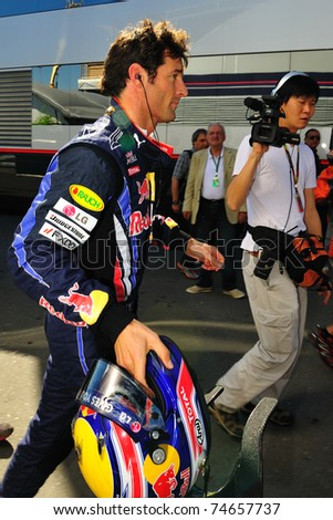 MONZA - SEPTEMBER 11: Red Bull Racing Team Driver, Mark Webber of Australia finished the practice when his car broke down on september 11, 2010 in monza, italy, formula 1 - stock photo