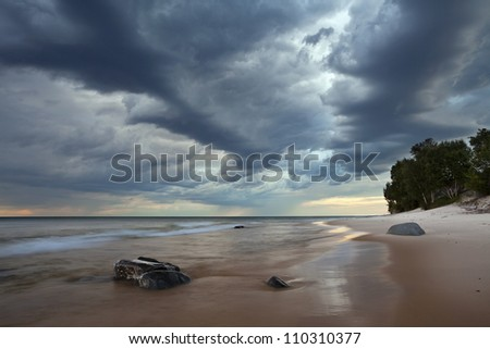 Moody Beach. Image of the beach and dramatic sky. - stock photo