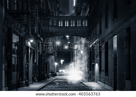 Moody monochrome view of Staple street skybridge by night, in Tribeca, New York City - stock photo
