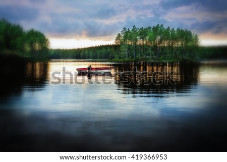 Moody photograph. Man in a rowboat. - stock photo