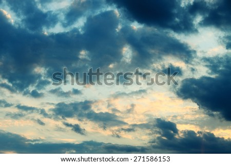 Moody stormy sky with glimpses of sunlight - stock photo