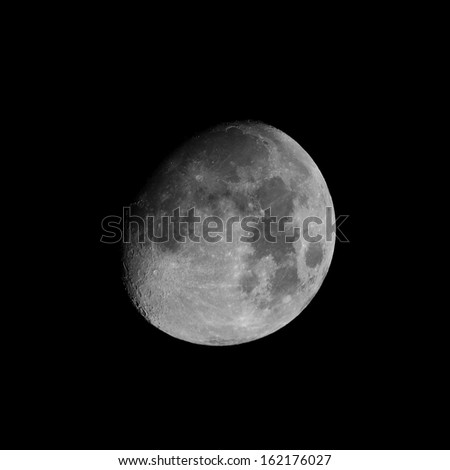Moon almost full seen from the northern hemisphere with a telescope in black and white - stock photo