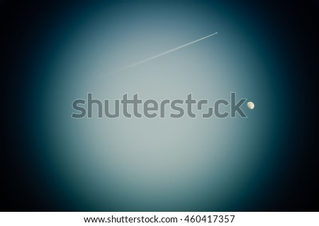 Moon and airplane seems look like they are under microscope - stock photo