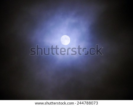 Moon and clouds in the fogy night - stock photo
