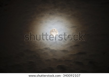Moon and Clouds 20 minutes before the Blood Moon Eclipse - stock photo