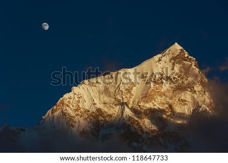 Moon and Nuptse (7864 m) at sunset (view from Kala Patthar) - Everest region, Nepal, Himalayas - stock photo