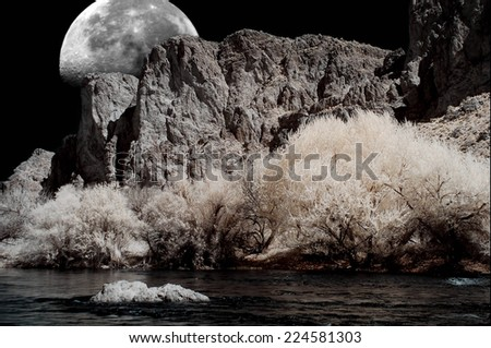 Moon and River in the winter Arizona desert mountains - stock photo