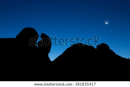 Moon and Rocks at Spitzkoppe in Namibia - stock photo