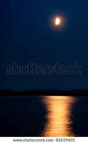 moon and the sea - stock photo