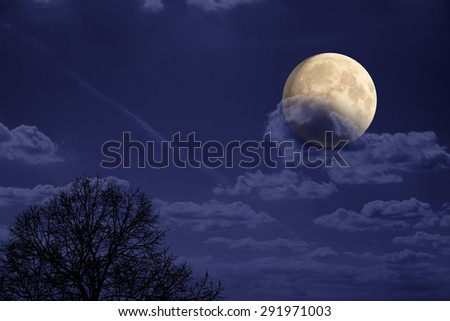 Moon behind clouds and among thousands of stars in deep space. My astronomy work. No elements of NASA or other third party. - stock photo