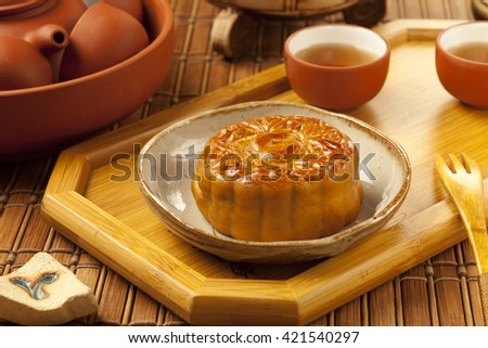 Moon cake and tea,Chinese mid autumn festival food.     - stock photo