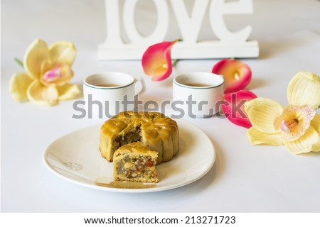 Moon cake, food for Chinese and Vietnamese mid-autumn festival. Mooncakes are offered between friends or on family gatherings while celebrating the festival - stock photo