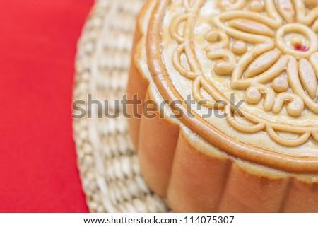 Moon cake on a bamboo mat.. - stock photo