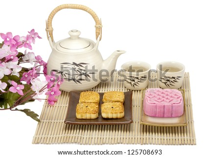 Moon cake two size with tea isolated - stock photo