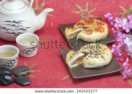 Moon cake with sesame topping and yolk inside - stock photo
