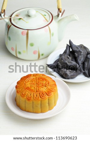 Moon cake with tea and water caltrop - stock photo