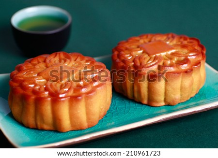 Moon cakes and teapot, Chinese mid autumn festival food  - stock photo