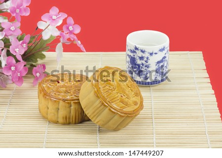 Moon cakes ,traditional chinese bakery on red background. - stock photo